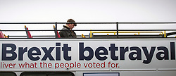 © Licensed to London News Pictures. 16/03/2019. Sunderland UK. Nigel Farage sits alone on the top deck of his Brexit bus as he takes a break from walking the March to Leave this morning which started from Ryhope beach in Sunderland & is a 270 mile walk to London, the march is said to be a peaceful protest to show the level of popular dissatisfaction with the way the Westminster elite are betraying the will of the people. Photo credit: Andrew McCaren/LNP