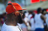 MIAMI - May 26, 2012: Guy listening music during the Miami Beach Urban Weekend, this is the largest Urban Festival in the World, that caters towards the Hip Hop Generation. Over 300.000 participants make the annual trek to South Beach for 4 days full of fun, food, festivities, entertainment, music, and more.