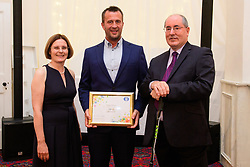 Lincolnshire Co-op long service awards 2018. Lincolnshire Co-op long service awards 2018. Lincolnshire Co-operative chief executive Ursula Lidbetter, left, and president Steve Hughes, right, present 25-year long service award to Roger Brown (General Maintenance Manager at Property Maintenance Lincoln)<br /> <br /> Picture: Chris Vaughan Photography for Lincolnshire Co-op<br /> Date: September 20, 2018