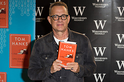 © Licensed to London News Pictures. 02/11/2017. London, UK.  Academy Award winning American actor TOM HANKS signs copies of his first book, Uncommon Type: Some Stories, a collection of 17 short stories focusing around the theme of typewriters at Waterstone's Piccadilly. Photo credit: Ray Tang/LNP