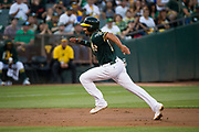 Oakland Athletics shortstop Marcus Semien (10) runs the bases to score a run against the San Francisco Giants at Oakland Coliseum in Oakland, California, on August 1, 2017. (Stan Olszewski/Special to S.F. Examiner)
