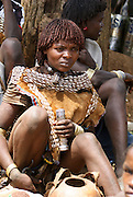 Africa, Ethiopia, Omo River Valley Banna Tribe woman and babies