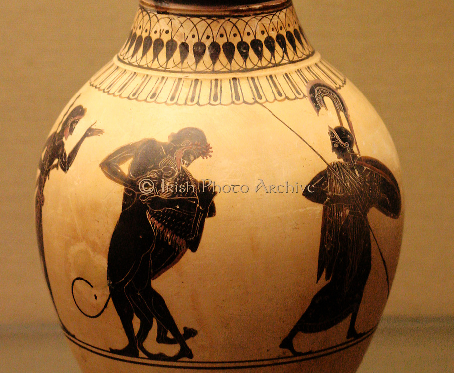 White-ground oinochoe (wine-jug): Heracles and the Nemean lion. Made in Athens about 520-500 BC; attributed to the painter of London.