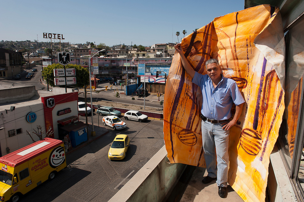 Cesar Hayashi is a painter whose work has been exhibited on both sides of the border. He is also a doctor, here on the roof of his office in Tijuana, March 2012.<br /> Tijuana, Baja California, Mexico.<br /> <br /> &copy; Stefan Falke<br /> www.stefanfalke.com<br /> LA FRONTERA: Artists along the US Mexican Border