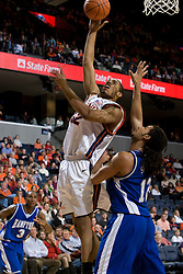 Virginia forward Mike Scott (32) shoots over Hampton Pirates forward Theo Smalling (12).  The Virginia Cavaliers men's basketball team defeated the Hampton Pirates 79-65 at the John Paul Jones Arena in Charlottesville, VA on December 19, 2007.