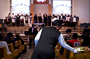 Communion is passed around during service at Zion Baptist Church in Madison, Wisconsin, Sunday, Feb. 4, 2018.
