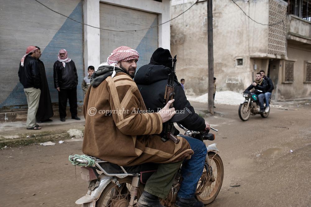 SYRIA - Al Qsair. Member of Free Syrian Armi ride a motorbike in Al Qsair, on February 10, 2012. ALESSIO ROMENZI