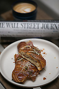 Wall Street Journal with Croissant and Latte