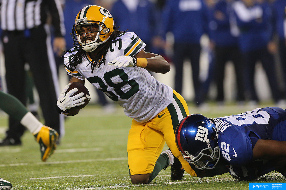 Tramon Williams, Green Bay Packers, after intercepting Eli Panning during the New York Giants Vs Green Bay Packers, NFL American Football match at MetLife Stadium, East Rutherford, New Jersey, USA. 17th November 2013. Photo Tim Clayton