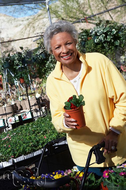Senior woman in garden center