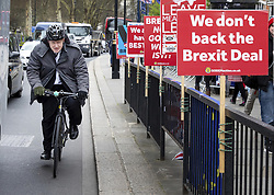 March 27, 2019 - London, UK - BORIS JOHNSON MP passes anti-Brexit placards in Westminster ahead of Prime Minister's Questions. Later today MPs are expected to vote on a series of indicative votes on alternative proposals to British Prime Minister Theresa May's withdrawal agreement. (Credit Image: © Tom Nicholson/London News Pictures via ZUMA Wire)