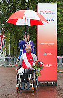 Heinz Freil (SUI) the third placed rider at the medal ceremony for the Mens Handcycle Classic at Prudential RideLondon, the world's greatest festival of cycling, involving 70,000+ cyclists – from Olympic champions to a free family fun ride - riding in five events over closed roads in London and Surrey over the weekend of 9th and 10th August. <br /> <br /> Photo: Neil Turner for Prudential Ride London<br /> <br /> Sunday 10th August 2014<br /> <br /> See www.PrudentialRideLondon.co.uk for more.<br /> <br /> For further information: Penny Dain 07799 170433<br /> pennyd@ridelondon.co.uk