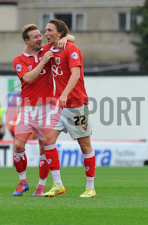 Bristol City's Wade Elliott and Bristol City's Luke Ayling share a joke during the match. - Photo mandatory by-line: Nizaam Jones- Mobile: 07583 3878221 - 27/09/2014 - SPORT - Football - Bristol - Ashton Gate - Bristol City v MK Dons - Sports