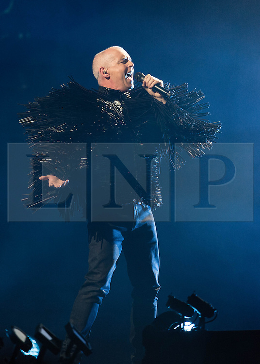© Licensed to London News Pictures. 18/06/2013. London, UK.   Pet Shop Boys performing live at The O2 Arena - Neil Tennent in this picture. Pet Shop Boys are an English electronic pop duo, consisting of Neil Tennant, who provides main vocals, keyboards and occasional guitar, and Chris Lowe on keyboards and occasional vocals.  Photo credit : Richard Isaac/LNP