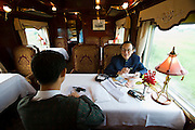 Eastern & Oriental Express. Mai?tre d' busy at the Saloon.