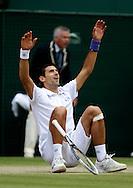 Wimbledon Championships 2011, AELTC,London,.ITF Grand Slam Tennis Tournament . Novak Djokovic (SRB) laesst sich rueckwaerts fallen beim Matchpunkt,Jubel,Freude,Emotion,.Einzelbild,Aktion,Ganzkoerper,Hochformat,