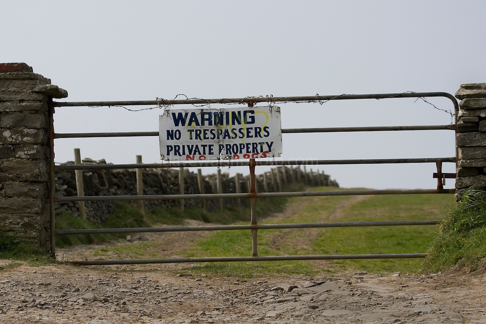 Warning, no trespassers, private property, no dogs - Sign near Hags Head at the Cliffs of Moher. Visitors are instead syphoned through an expensive car parking sysem to see a less interesting part of the cliffs..