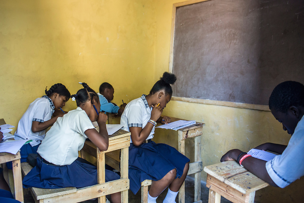 Students take their end-of-semester exams at Institution Mixte de la Fraternite, a school in the Fort National neighborhood, on Friday, December 19, 2014 in Port-au-Prince, Haiti. Fort National was among the hardest hit areas of Port-au-Prince in the 2010 earthquake, but rebuilding has been slow to non-existent. Residents still mostly lack electricity and running water.