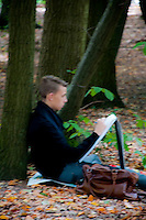 Young artist sketching in Middleheim Sculpture Park, Antwerp, Belgium