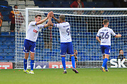 Bury striker Jermaine Beckford (9) and Bury defender Eoghan O'Connell (6) celebrate during the EFL Sky Bet League 1 match between Bury and Bradford City at the Energy Check Stadium at Gigg Lane, Bury, England on 14 October 2017. Photo by Richard Holmes.