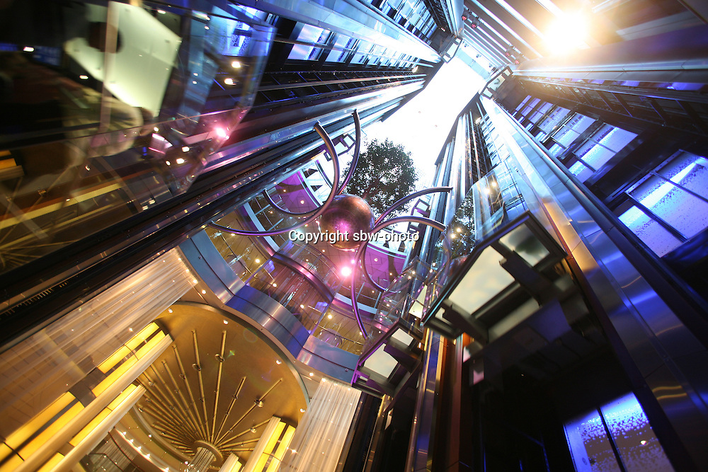 Celebrity Eclipse interior photos..A lift atrium with suspended tree..