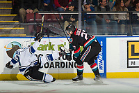 KELOWNA, CANADA - NOVEMBER 23: Lane Zablocki #27  of the Kelowna Rockets checks Remy Aquilon #3 of the Victoria Royals during first period  on November 23, 2018 at Prospera Place in Kelowna, British Columbia, Canada.  (Photo by Marissa Baecker/Shoot the Breeze)