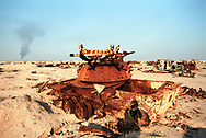 The toxic and radioactive remains of tanks and military vehicles destroyed by depleted uranium weapons during the Gulf War scattered along the Iraq-Kuwait border.<br />