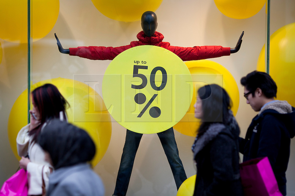 © Licensed to London News Pictures. 26/12/2012. London, UK. As thousands across the UK take advantage of Boxing Day sales shoppers walk past a sale sign on Oxford Street in London today (26/12/12). Photo credit: Matt Cetti-Roberts/LNP