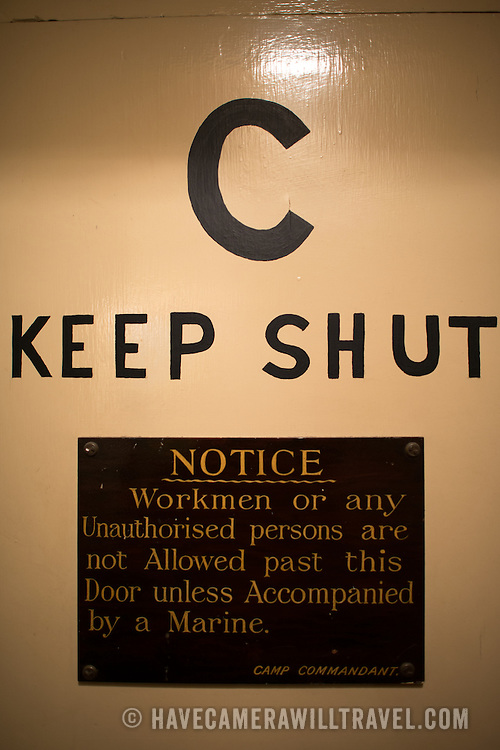 A warning sign on a door at the Churchill War Rooms in London. The museum, one of five branches of the Imerial War Museums, preserves the World War II underground command bunker used by British Prime Minister Winston Churchill. Its cramped quarters were constructed from a converting a storage basement in the Treasury Building in Whitehall, London. Being underground, and under an unusually sturdy building, the Cabinet War Rooms were afforded some protection from the bombs falling above during the Blitz.
