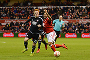 Nottingham Forest midfielder, on loan from Benfica, Hildeberto Pereira (17) clashes with Brentford midfielder Ryan Woods (15) during of the EFL Sky Bet Championship match between Nottingham Forest and Brentford at the City Ground, Nottingham, England on 7 March 2017. Photo by Jon Hobley.