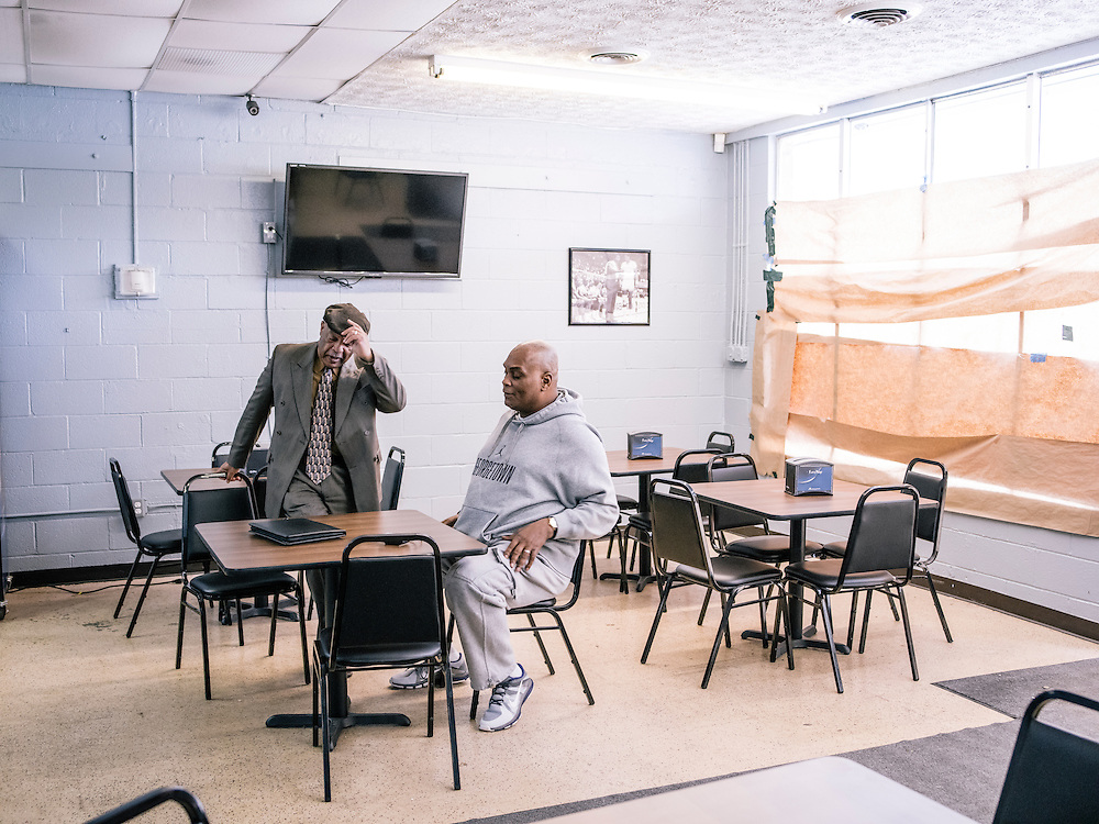 Michael Graham meets with his insurance agent Lennie Thomas at his soon to be open restaurant, Michael G's Breakfast & BBQ.