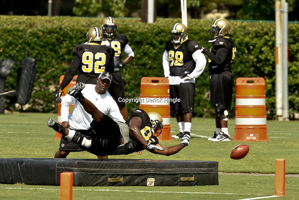 August 1, 2010; Metairie, LA, USA; New Orleans Saints defensive end Jimmy Wilkerson (99) dives for a ball during a drill during a training camp practice at the New Orleans Saints practice facility. Mandatory Credit: Derick E. Hingle
