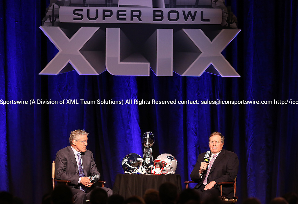 30 January 2015: New England Patriots head coach Bill Belichick (right) and Seattle Seahawks head coach Pete Carroll (left) speak to the media during the Super Bowl XLIX press conference at the Phoenix Convention Center in Phoenix, Az.