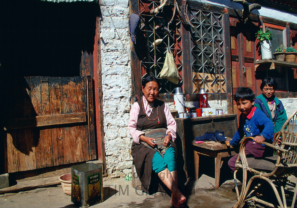 Woman and children at home in Paro, Bhutan