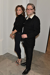 MARIE HELVIN and DAVID DOWNTON at a private view of photographs by David Bailey entitled 'Bailey's Stardust' at the National Portrait Gallery, St.Martin's Place, London on 3rd February 2014.