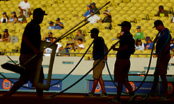 June 20, 2017 - Los Angeles, California, U.S. - Los Angeles Dodgers grounds crew prepares the field prior to a Major League baseball game against the New York Mets at Dodger Stadium on Tuesday, June 20, 2017 in Los Angeles. (Photo by Keith Birmingham, Pasadena Star-News/SCNG) (Credit Image: © San Gabriel Valley Tribune via ZUMA Wire)