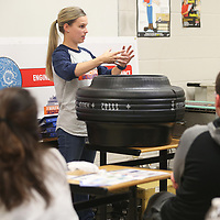 Jessica Sinack, a tire engineer with Cooper Tire, talks about testing the performance of tires with vo-tech students Friday morning at Tupelo High School.