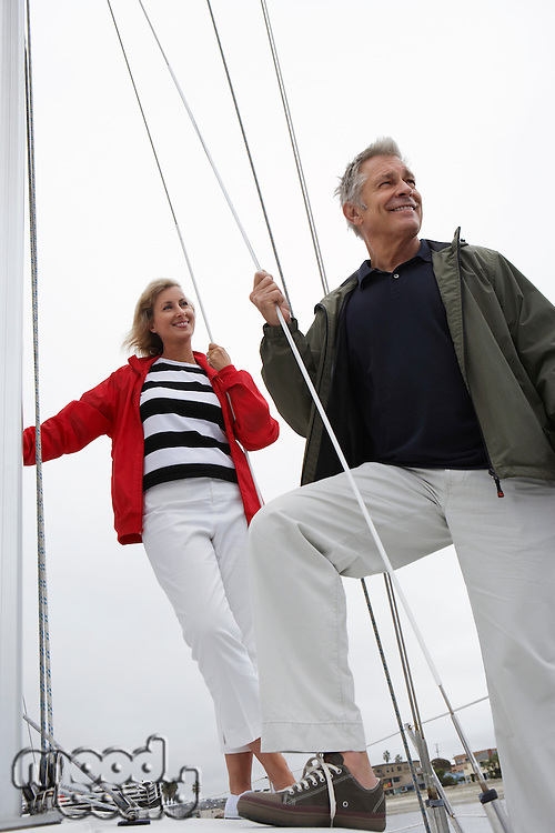 Couple on yacht, low angle view