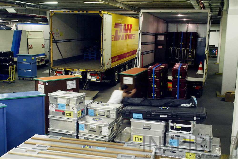BRUSSELS - BELGIUM - 12 MAY 2006 -- Workers from the EU Parliament loading the trucks leaving for Strasbourg. 732 MEPs have offices in Strasbourg and Brussels. Every month they and their staff move between the 2 cities and uses this kind of boxes for the documents and other stuff. The MEP also calls it the commuting circus. PHOTO: ERIK LUNTANG /