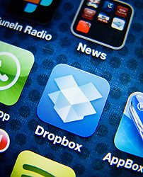 detail of iPhone 4G screen showing Dropbox online cloud storage app icon