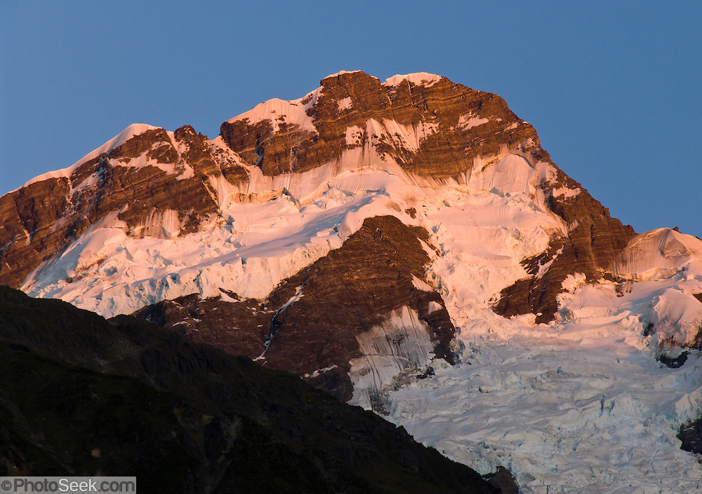 Sunrise brightens Mount Sefton in Aoraki / Mount Cook National Park, South Island, New Zealand. In 1990, UNESCO honored Te Wahipounamu - South West New Zealand as a World Heritage Area.