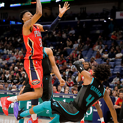 Apr 3, 2019; New Orleans, LA, USA;  Charlotte Hornets guard Devonte' Graham (4) draws an offensive foul from New Orleans Pelicans forward Christian Wood (35) during the second half at the Smoothie King Center. Mandatory Credit: Derick E. Hingle-USA TODAY Sports