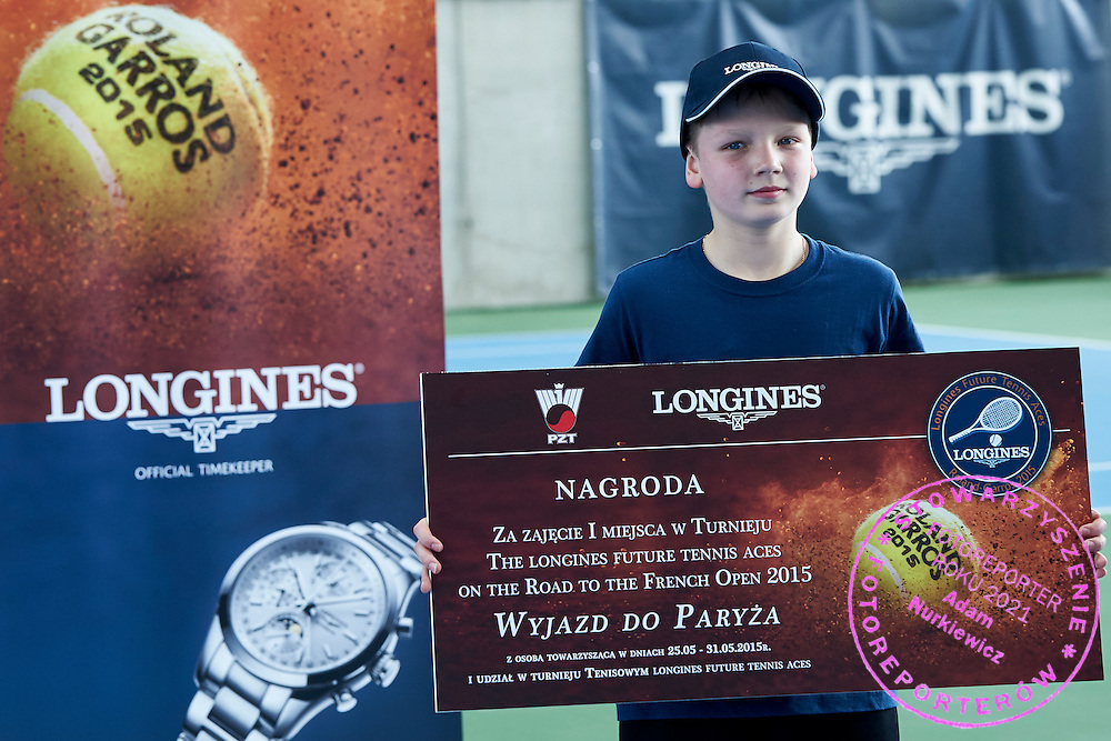 Maksymilian Kasnikowski from Poland under-14 tennis player while victory ceremony during the Longines Future Tennis Aces 2015 at Tuan Tennis Club in Jozefoslaw near Warsaw on April 11, 2015.<br /> <br /> Poland, Warsaw, April 11, 2015<br /> <br /> Picture also available in RAW (NEF) or TIFF format on special request.<br /> <br /> For editorial use only. Any commercial or promotional use requires permission.<br /> <br /> Mandatory credit:<br /> Photo by &copy; Adam Nurkiewicz / Mediasport