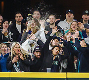 Whenever a home run is hit at Safeco Field, there's a moment when you look away from the player who hit it, and focus on the ball's flight into the stands. It's predictable: Fans get so excited that they forget — every time, it seems — what they are doing, or what they happen to be holding, and lunge after the ball, sending everything into the air. (Dean Rutz / The Seattle Times)