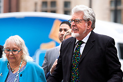 © Licensed to London News Pictures. 23/09/2013. London, UK. Artist and television celebrity Rolf Harris and his wife Alwen Hughes are seen arriving at Westminster Magistrates Court in London today (23/09/2013). Harris, 83, has been charged with nine counts of indecent assault and four counts of making indecent images of a child. The alleged indecent assaults date from 1980 to 1986 and relate to two complainants aged 14 and 15 at the timePhoto credit: Matt Cetti-Roberts/LNP
