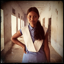 "iPhone portrait of Sunita Bairwa, 18, in a village outside of Tonk, Rajasthan, India, April 3, 2013. ""I told my father, 'Papa don't get me married, I will study.' Dad said, 'No I will get you married.' Then the teacher went and talked to my father, scolded my father, and then my father understood somehow. He said, 'OK, we'll not get her married and we'll listen to you.' "" said Bairwa.<br /> <br /> Under Indian law, children younger than 18 cannot marry. Yet in a number of India's states, at least half of all girls are married before they turn 18, according to statistics gathered in 2012 by the United Nations Population Fund (UNFPA). However, young girls in the Indian state of Rajasthan—and even a few boys—are getting some help in combatting child marriage. In villages throughout Tonk, Jaipur and Banswara districts, the Center for Unfolding Learning Potential, or CULP, uses its Pehchan Project to reach out to girls, generally between the ages of 9 and 14, who either left school early or never went at all. The education and confidence-building CULP offers have empowered young people to refuse forced marriages in favor of continuing their studies, and the nongovernmental organization has provided them with resources and advocates in their fight."