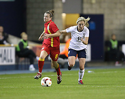 England's Toni Duggan (Everton) vies for possession with Wales's Hayley Ladd - Coventry - Photo mandatory by-line: Robin White/JMP - Tel: Mobile: 07966 386802 26/10/2013 - SPORT - FOOTBALL - The Den - Millwall - England Women v Wales Women - World Cup Qualifier - Group 6