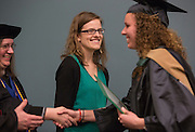 Shauna Happel, right,  receives her graduation certificate while Katie Hankins, an admissions advisor, looks on during the Ohio University College of Business Commencement Ceremony on April 9, 2016. <br /> Ohio University College of Business class of 2016