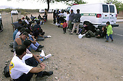 Undocumented migrants wait to be processed and deported in Sells, Arizona, on the Tohono O'odham Nation, Sonoran Desert, USA.