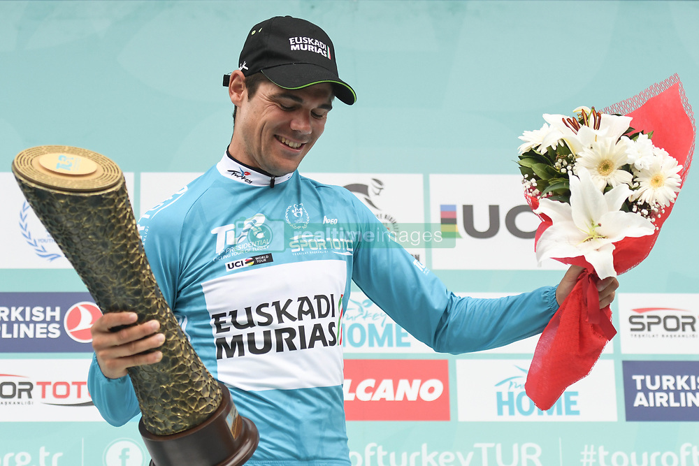 October 14, 2018 - Istanbul, Turkey - Happy Eduard Prades Reverter of Spain and Euskadi Basque Country-Murias celebrates with the TUR Trophy after he wins the general classification of the 54th Presidential Cycling Tour of Turkey 2018. .On Sunday, October 14, 2018, in Istanbul, Turkey. (Credit Image: © Artur Widak/NurPhoto via ZUMA Press)